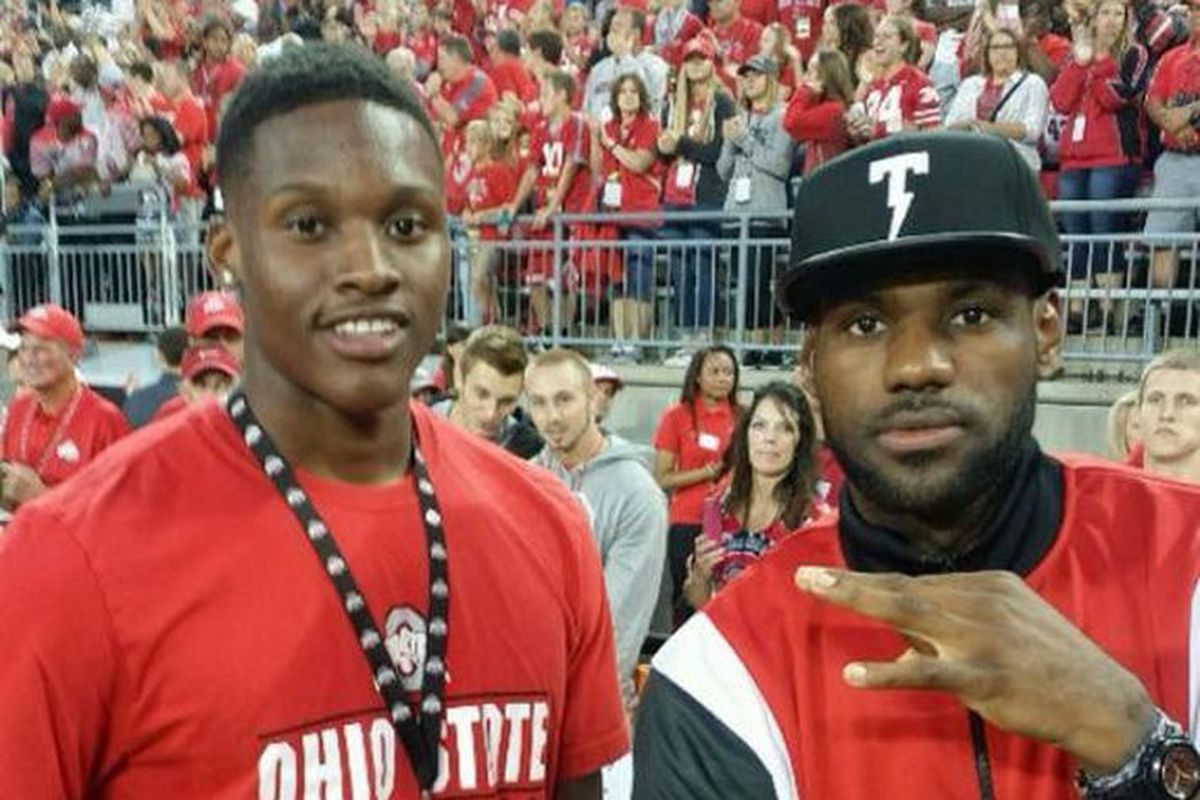 David Bell poses with LeBron James at an Ohio State football game in 2014.