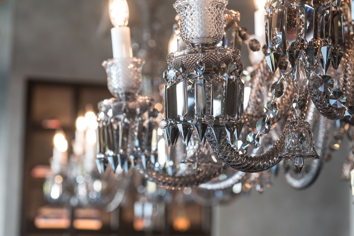 A closeup of a silver chandelier with spiky accents.