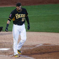 Salt Lake Bees third baseman Kaleb Cowart (22) throws his helmet after striking out during a game at Smith's Ballpark in Salt Lake City on Monday, June 5, 2017.
