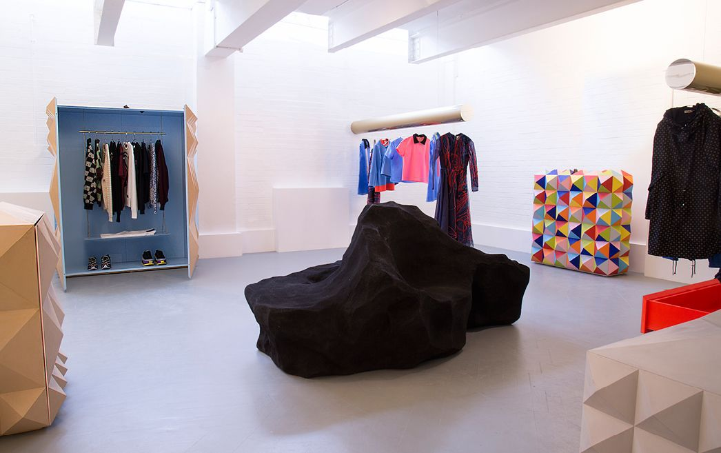 Clothes hanging in a gallery-like space