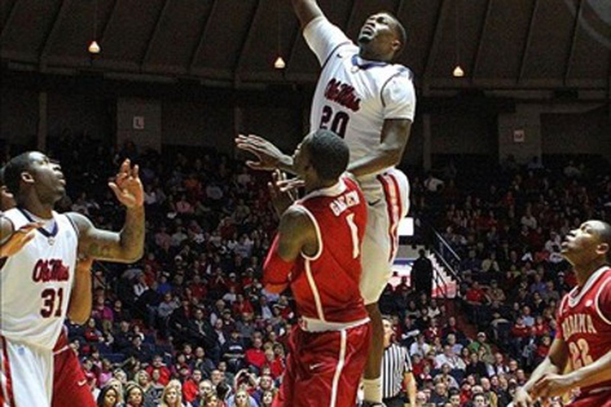 Nick Williams shoots over JaMychal Green during Saturday's 60-51 victory over Alabama.