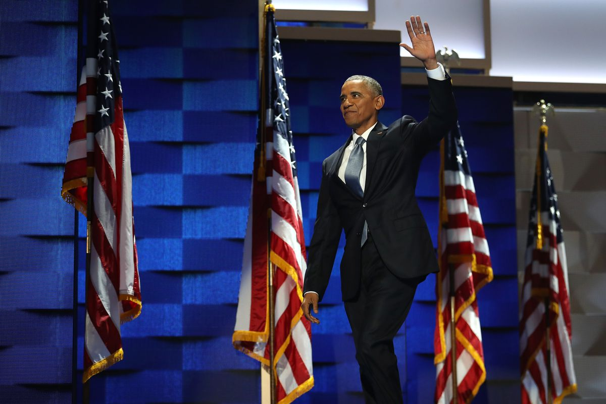 US President Barack Obama acknowledges the crowd as he arrives on stage to deliver remarks on the third day of the Democratic National Convention at the Wells Fargo Center, July 27, 2016