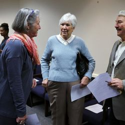 Michele Straube, left, Gail Miller and Palmer DePaulis talk at the Salt Lake County Government Center in Salt Lake City on Wednesday, Dec. 9, 2015.