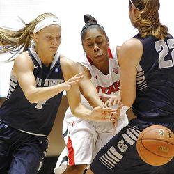 Utah's Iwalani Rodrigues, center, tries to steal the ball from Utah State's Devyn Christensen, left, as Utah and Utah State play Nov. 27, 2012, in the Huntsman Center. Utah won 92-64.