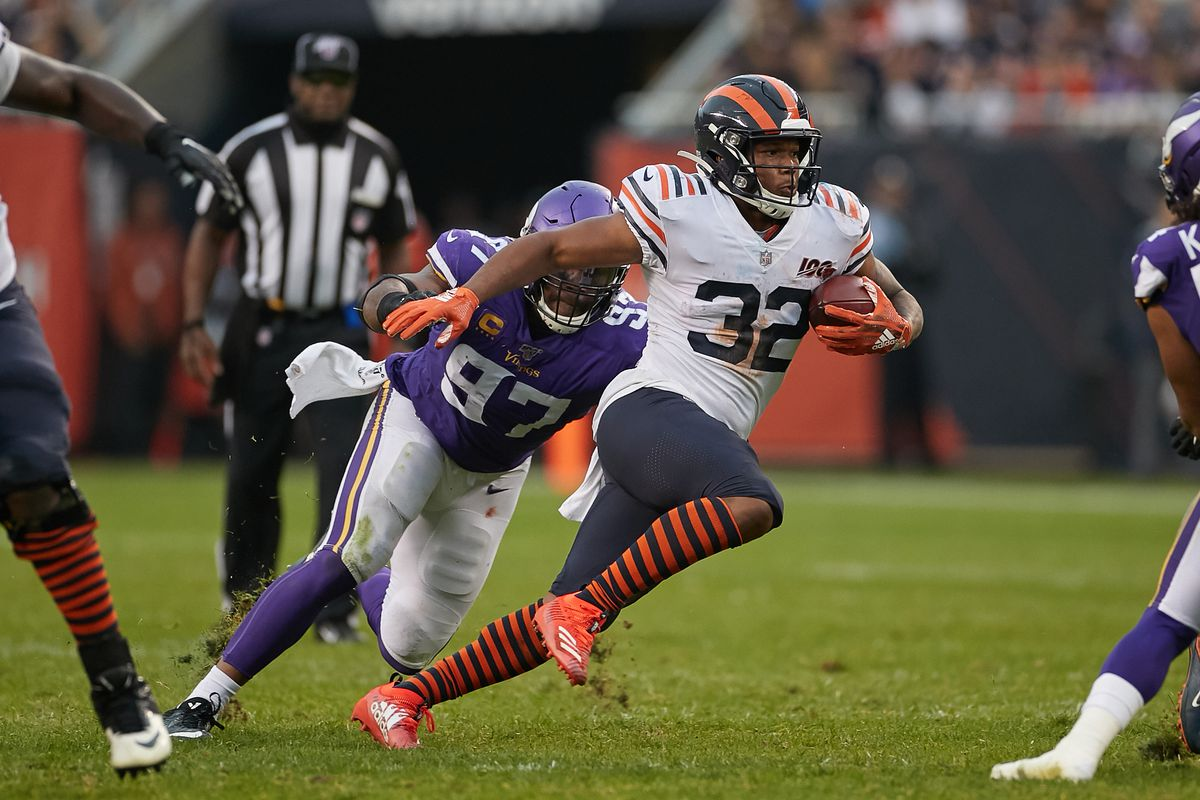 Chicago Bears running back David Montgomery runs with the football past Minnesota Vikings defensive end Everson Griffen in game action during a game between the Chicago Bears and the Minnesota Vikings on September 29, 2019 at Soldier Field in Chicago, IL.