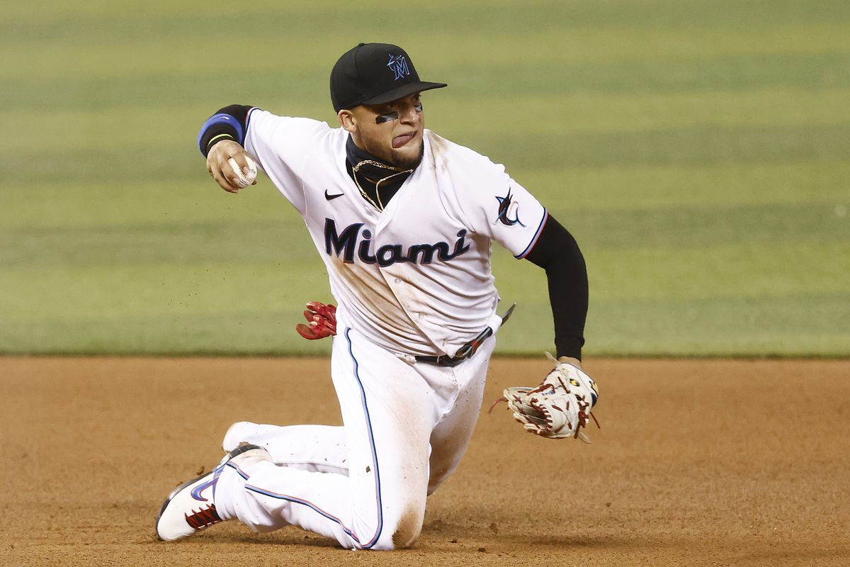 Isan Diaz #1 of the Miami Marlins throws out a runner at second base against the Colorado Rockies at loanDepot park