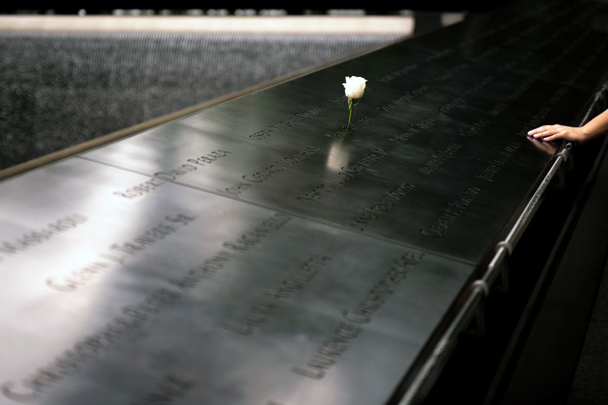 Visitors placed roses on the 9/11 Memorial at the World Trade Center, July 2, 2021.