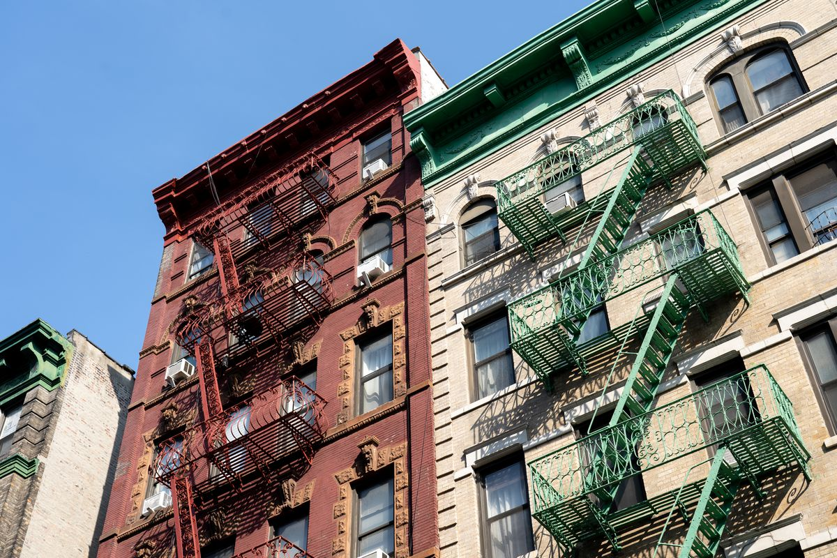 Two buildings with fire escapes.