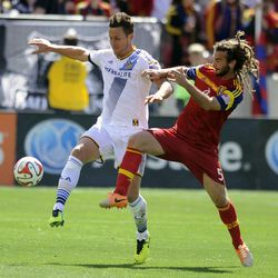 Real Salt Lake midfielder Kyle Beckerman (5) and Los Angeles Galaxy forward Rob Friend (16) fight for the ball during a game at Rio Tinto Stadium on Saturday, March 22, 2014.