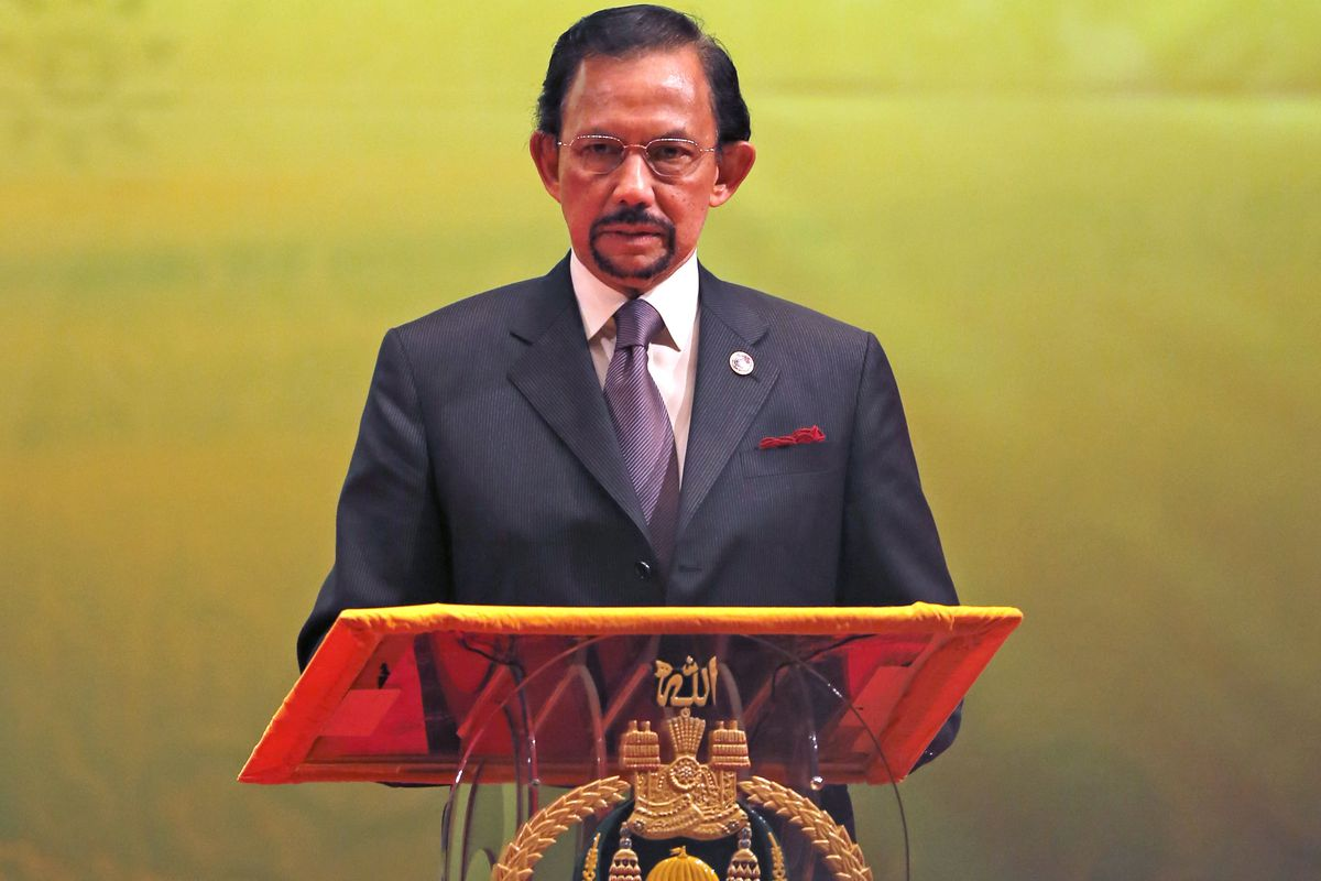 In this Oct, 10, 2013, photo, Brunei's Sultan Hassanal Bolkiah speaks during the closing ceremony and handover of the ASEAN Chairmanship to Myanmar in Bandar Seri Begawan. The sultan announced to implement Islamic criminal laws that punishes gay sex by st