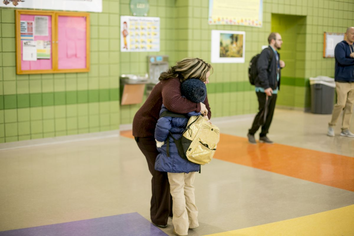 Principal Melissa Villarreal greets a student as he arrives for class at Earhart Elementary-Middle School in southwest Detroit.