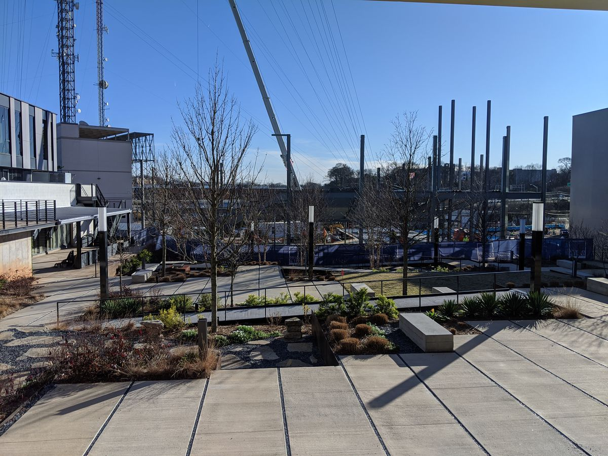 A daytime view of the back yard garden and under-construction concert venue.