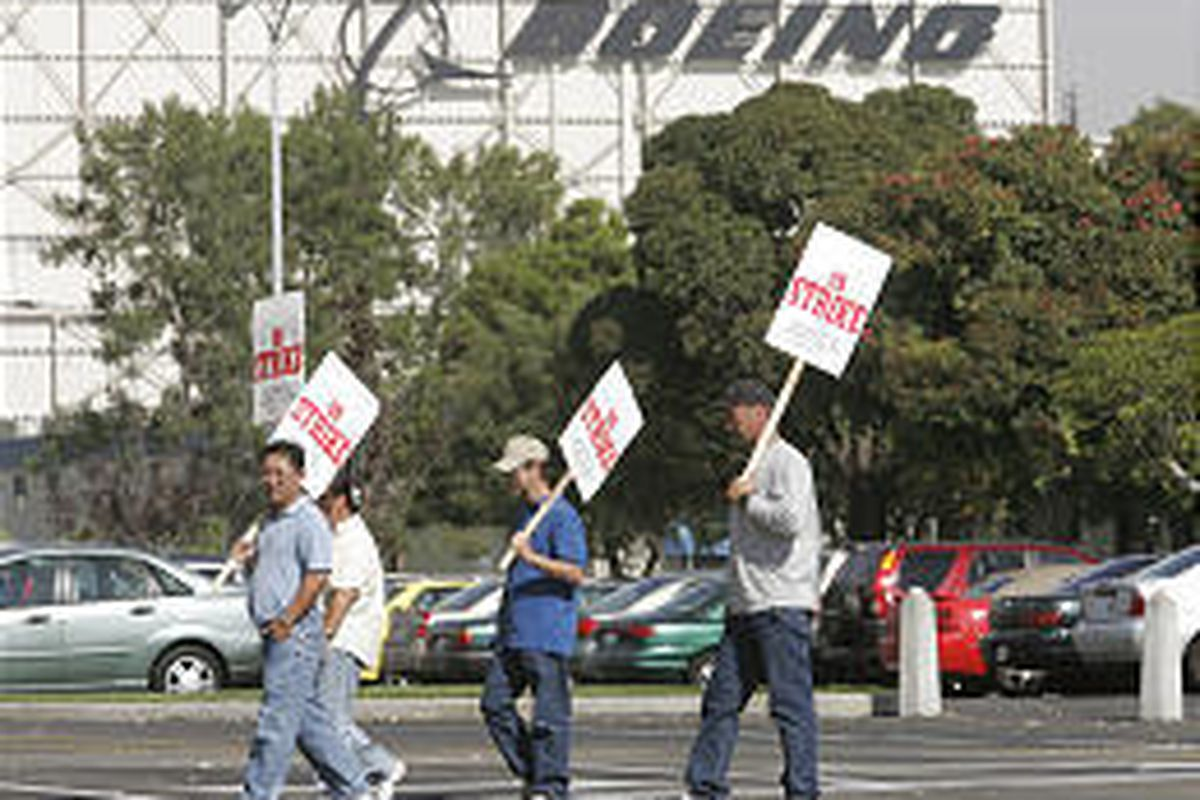 Striking members of the International Association of Machinists and Aerospace Workers march at the Boeing Co. plant Wednesday in Huntington Beach, Calif. Machinists also went on strike in Alabama and Florida.