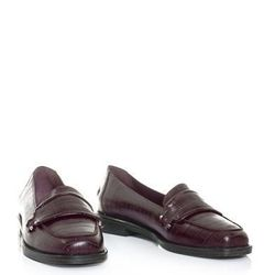 """<a href=""""http://www.matchesfashion.com/product/170736"""">Luxor embossed leather penny loafers by Opening Ceremony</a>, $133 (were $301)"""