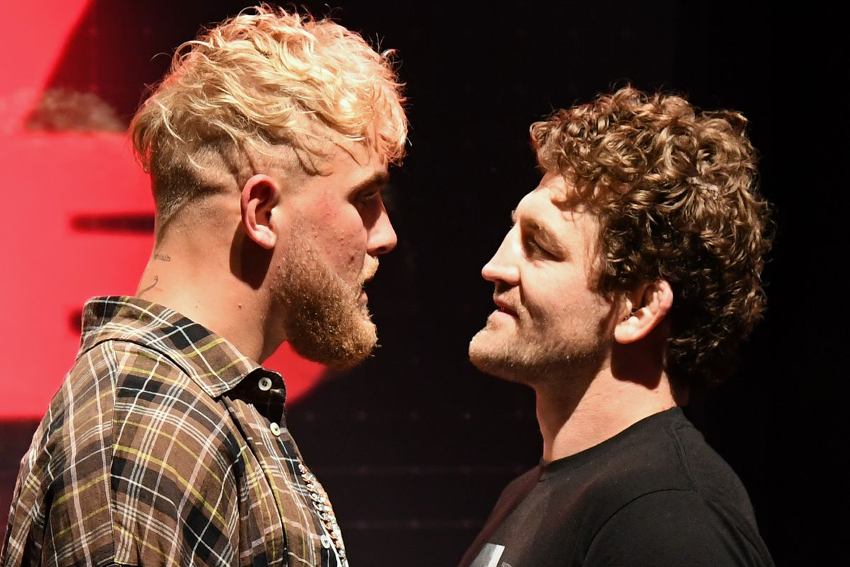 Jake Paul and Ben Askren face off during a news conference for Triller Fight Club's inaugural 2021 boxing event at The Venetian Las Vegas on March 26, 2021 in Las Vegas, Nevada. Paul and Askren will face each other in the main event that will take place on April 17, 2021, at Mercedes-Benz Stadium in Atlanta.