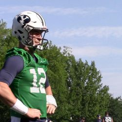 BYU quarterback Tanner Mangum warms up before practice as the Cougars open fall camp on Friday, Aug. 5, 2016.