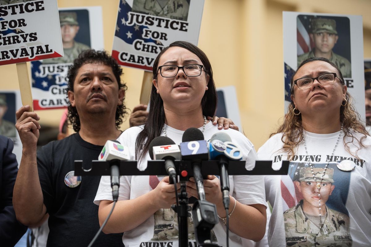 National Guardsman Chrys Carvajal's sister Jennifer Ramirez speaks during a protest demanding justice for Carvajal and asking the Cook County State's Attorney's office to re-examine the evidence in the case in the Loop, Friday morning, Aug. 13, 2021. Carvajal was fatally shot in July in the 2200 block of North Lockwood Avenue, according to police. | Pat Nabong/Sun-Times