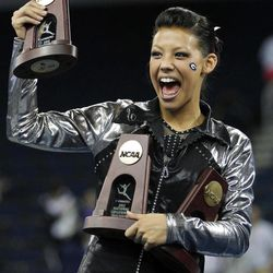 Georgia's Kat Ding jokes with the crowd after collecting her trophies at the NCAA women's individual gymnastics championships on Sunday, April 22 2012, in Duluth, Ga. Ding was first in the floor exercise and the uneven bars and third in the vault.