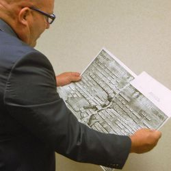 Todd Knowles, a specialist in Jewish genealogy, looks at a copy of an old pedigree chart showing Jewish generations.