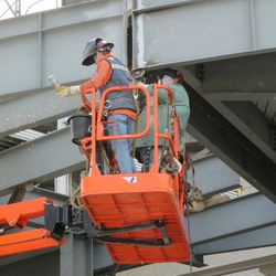 3:14 p.m. Working on one of the gaps in the bleacher patio behind the scoreboard -