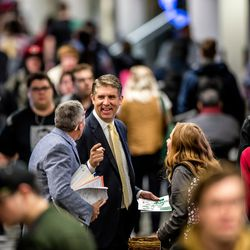 Utah Valley University President Matthew S. Holland welcomes students in the hall near the UVU Bookstore on the first day of spring semester on the UVU campus in Orem on Monday Jan. 9, 2017.
