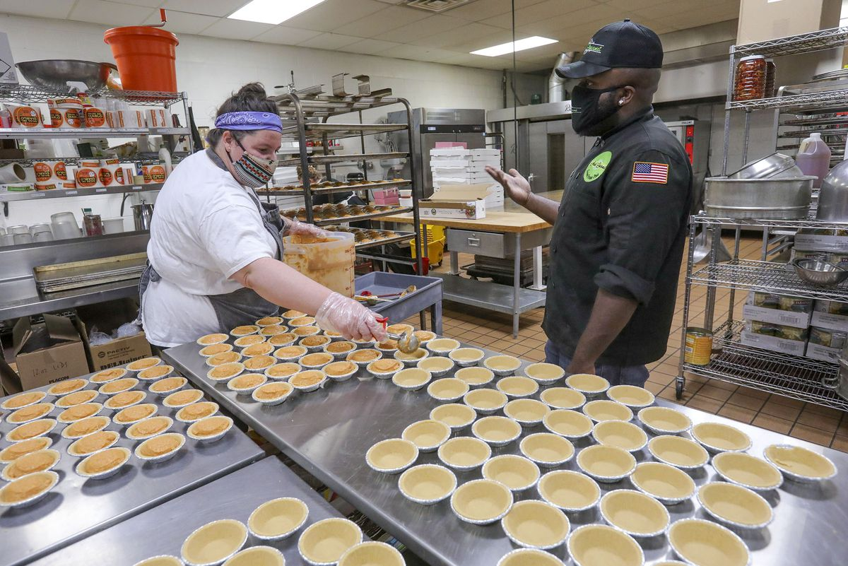 Paige Moore and James Edwards make gourmet pies in a shared commercial kitchen.