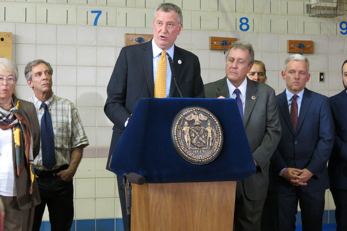 """Mayor Bill de Blasio touted """"important reforms"""" in his budget plan and the proposed teachers contract at a press conference Monday at P.S. 69 in Queens."""