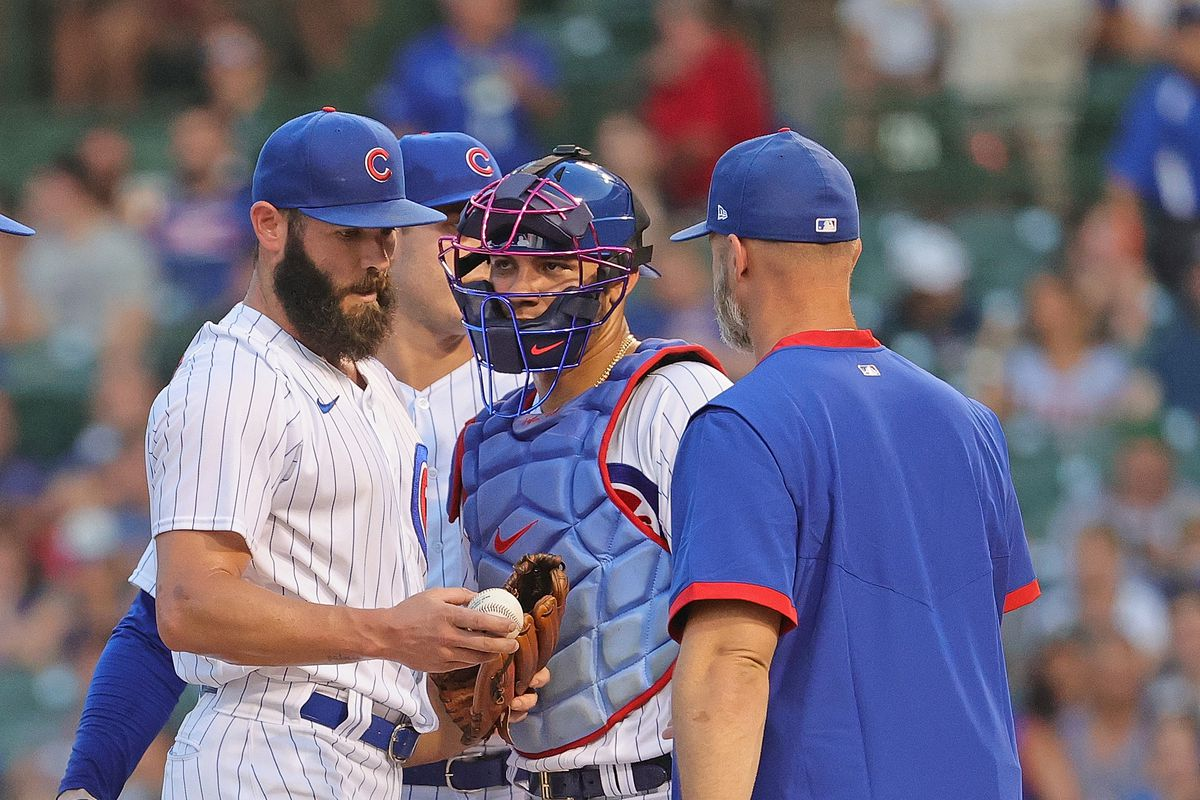 Cubs manager David Ross removes starting pitcher Jake Arrieta from the game against the Philadelphia Phillies in the top of the second inning at Wrigley Field Tuesday night.
