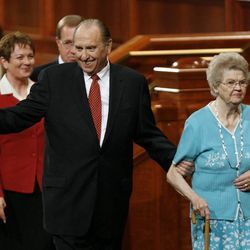 President Thomas S. Monson waves as he leaves a regional conference of the Church of Jesus Christ of Latter Day Saints held in the Conference Center in Salt Lake City, Utah, September 14, 2008. He is holding the arm of his wife Frances. At far right is Ann Dibb, daughter of President and Sister Monson. At far left behind President Monson is Cheryl C. Lant and her husband John Lant.