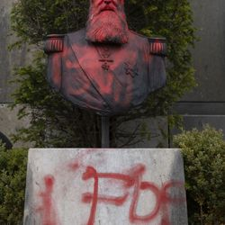 In this photo taken on Tuesday, June 9, 2020, a bust of Belgium's King Leopold II is smeared with red paint and graffiti in Tervuren, Belgium. With the protests sweeping the world in the wake of the killing of George Floyd in Minneapolis, King Leopold II is now increasingly seen as a stain on the nation as demonstrators demand he disappear from public view and authorities take heed. Statues of the late king have defaced in at least a half dozen cities across Belgium.