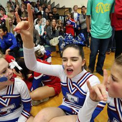 From left, Fremont High School cheerleaders Kennedee Hansen, Kennedy Hansen and Kendee Sanders cheer for teammates in the jump competition at the state championships at Juan Diego Catholic High School in Draper on Saturday, Feb. 15, 2014. Kennedy recently died of juvenile Batten disease.