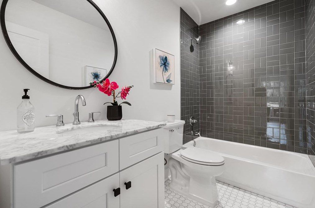 A white and gray bathroom.