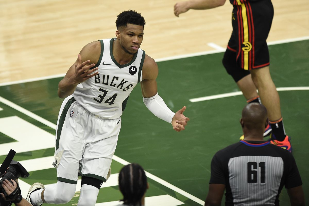 Giannis Antetokounmpo #34 of the Milwaukee Bucks celebrates after a basket against the Atlanta Hawks during the first half in game two of the Eastern Conference Finals at Fiserv Forum on June 25, 2021 in Milwaukee, Wisconsin.