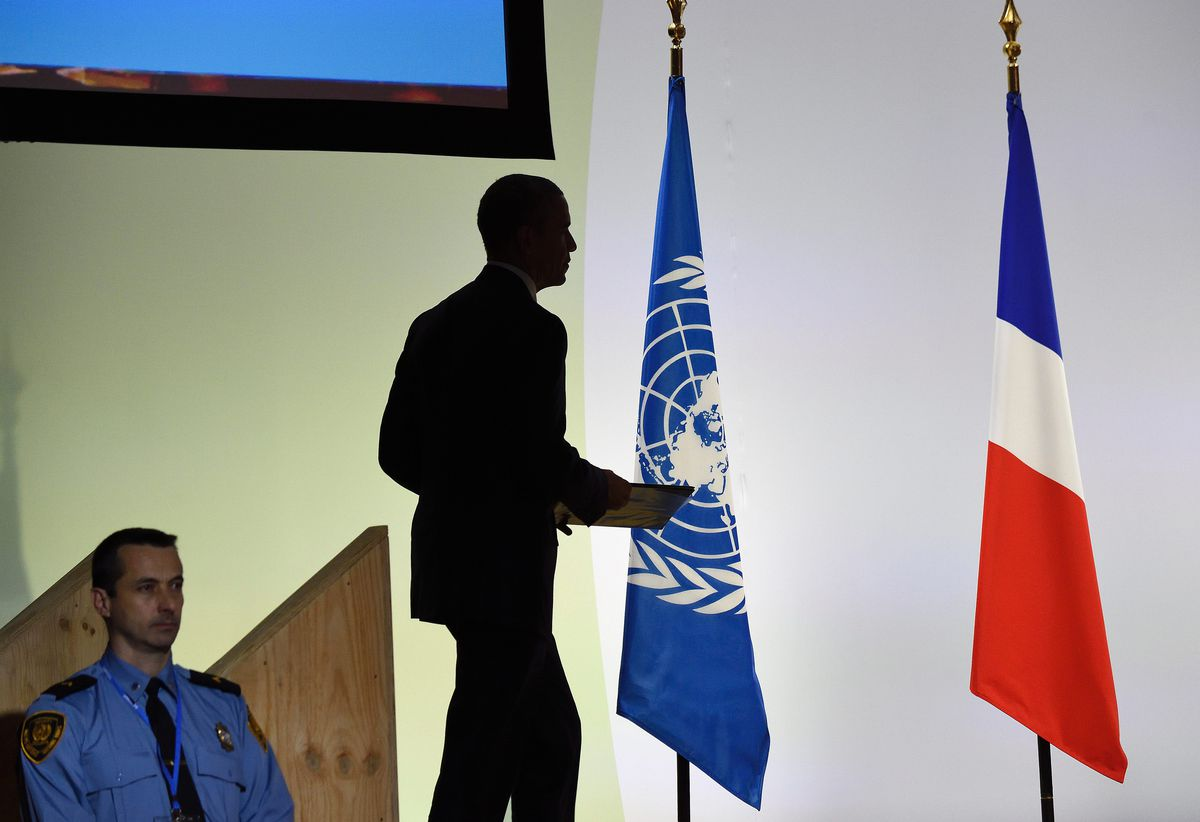 Obama's shadow, at the Paris climate talks.