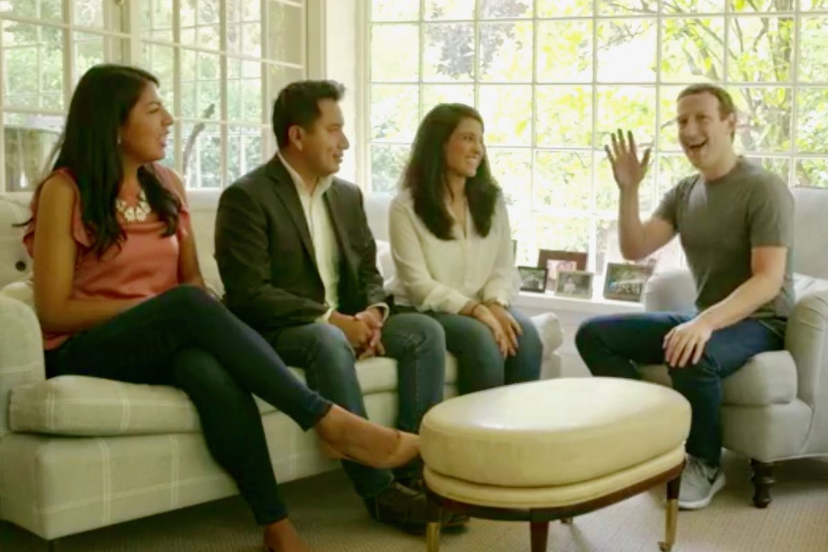 Facebook CEO Mark Zuckerberg waves to the camera while chatting at his house with three DACA Dreamers.