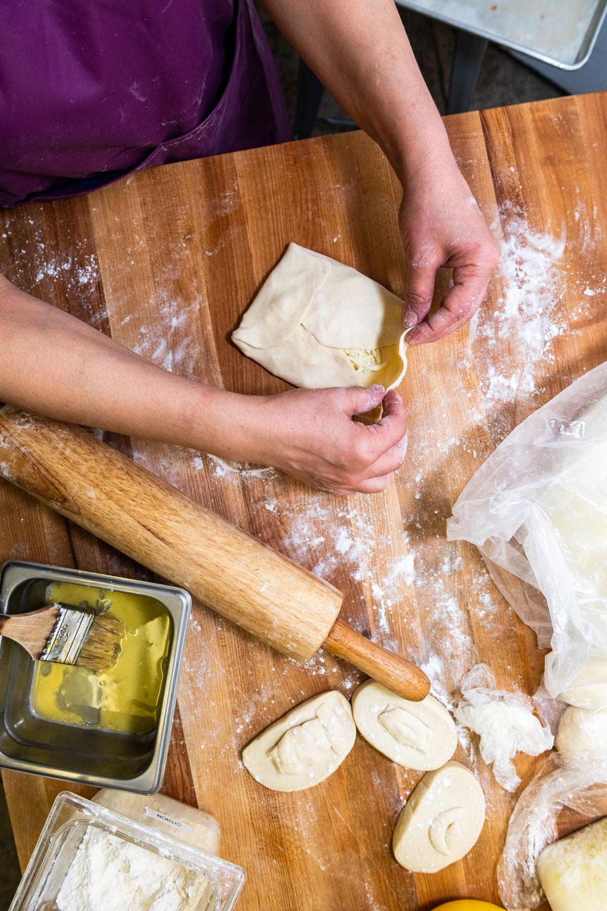 Ilhama Safarova folds a savory square of cheese-stuffed xachapuri.