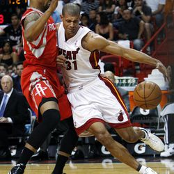 Miami Heat forward Shane Battier (31) drives against Houston Rockets forward Marcus Morris during the first half of an NBA basketball game, Sunday, April 22, 2012, in Miami.