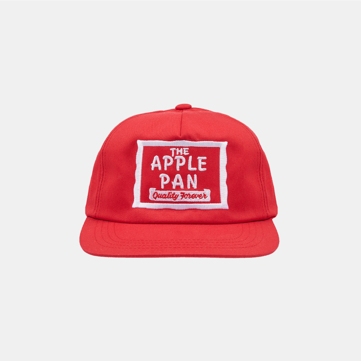A red collaboration hat with old school burger option the Apple Pan.