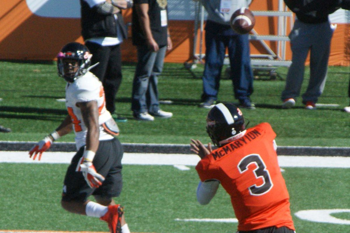 Marecus McMaryion, above throwing a swing pass to Storm Barrs-Woods, has reentered the Oregon St. starting quarterback competition.