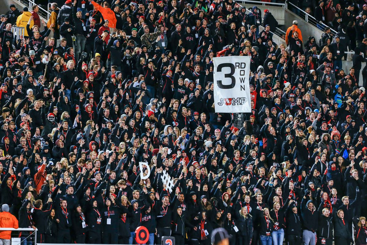 The Mighty Utah Student Section (MUSS), show here during a blackout game, are known for their 3rd Down Jump tradition.
