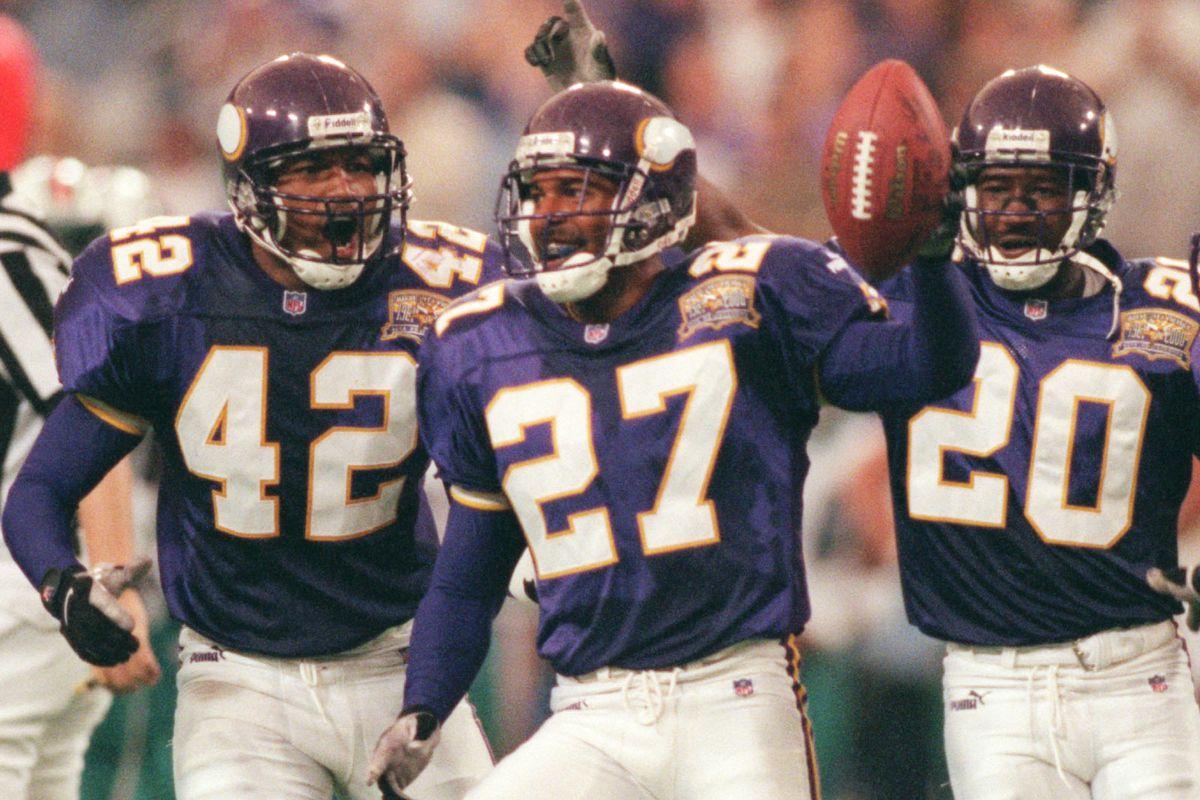 GENERAL INFORMATION: Vikingsvs. Miami Dolphins, Sunday, Sept. 10, 2000 IN THIS PHOTO: Minneapolis Mn, Sunday 9/10/00 Vikings vs Miami----Keith Tribodeaux (27) of Minnesota celebrated his 3rd quarter interception with teamates OrlandoThomas (42) and Ken