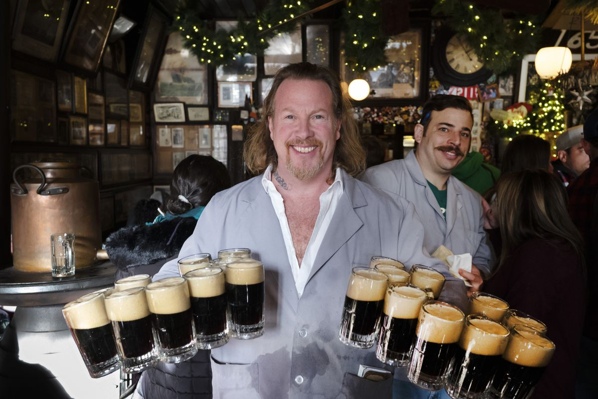 Gregory de la Haba serves 20 mugs of beer for a table of customers in McSorley's Old Ale House in New York. Located in Manhattan's Lower East Side, McSorley's opened in the mid-19th century and remained open as a speakeasy during Prohibition.