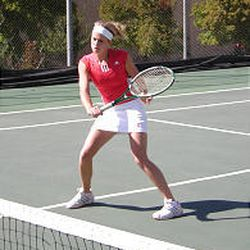 Markay Mullen of East High School's tennis team rallies. East knows what it takes to win and plans to do it.