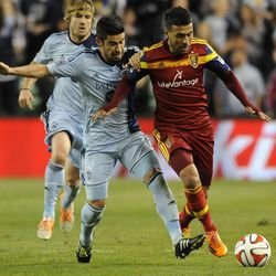 Real Salt Lake's Javier Morales fights with Sporting KC's Paulo Nagamura with the ball during a game at Sporting Park in Kansas City, Kan., on Saturday, April 5, 2014.