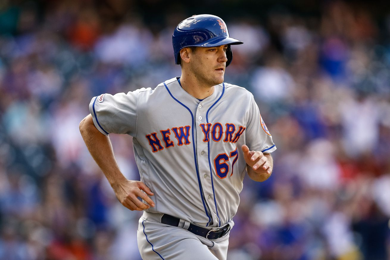 Mets rally with four runs in ninth to defeat Rockies