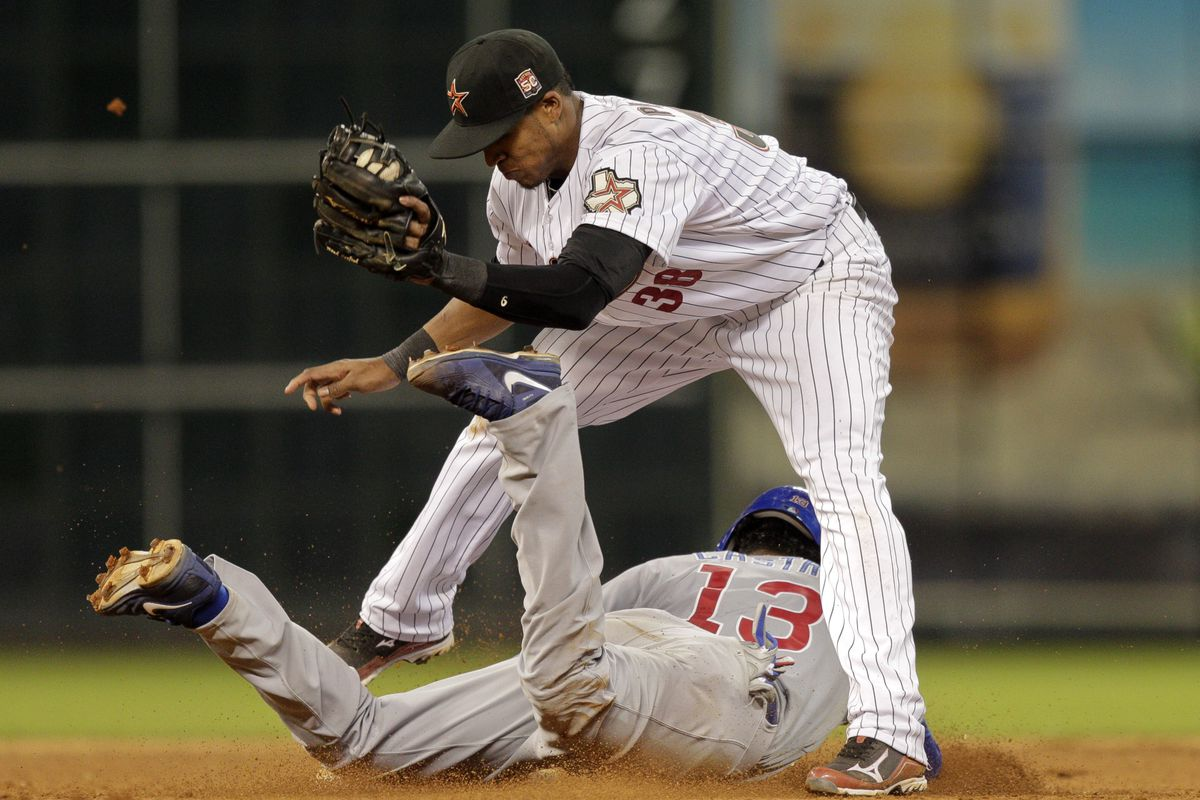 Starlin Castro of the Chicago Cubs slides between the legs of Jimmy Paredes of the Houston Astros as he steals second base at Minute Maid Park in Houston, Texas. (Photo by Bob Levey/Getty Images)