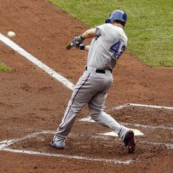 Texas Rangers' Michael Young hits a double against Minnesota Twins pitcher Liam Hendriks during the fourth inning of a baseball game on Sunday, April 15, 2012, in Minneapolis. The Rangers defeated the Twins 4-3.