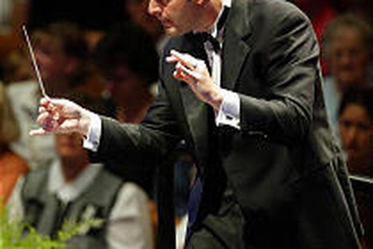 Barlow Bradford, conducting in 2002, says audiences enjoy singing along with the carols.
