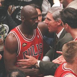 Jazz coach Jerry Sloan congratulates Michael Jordan after the Bulls won their sixth title in eight years.