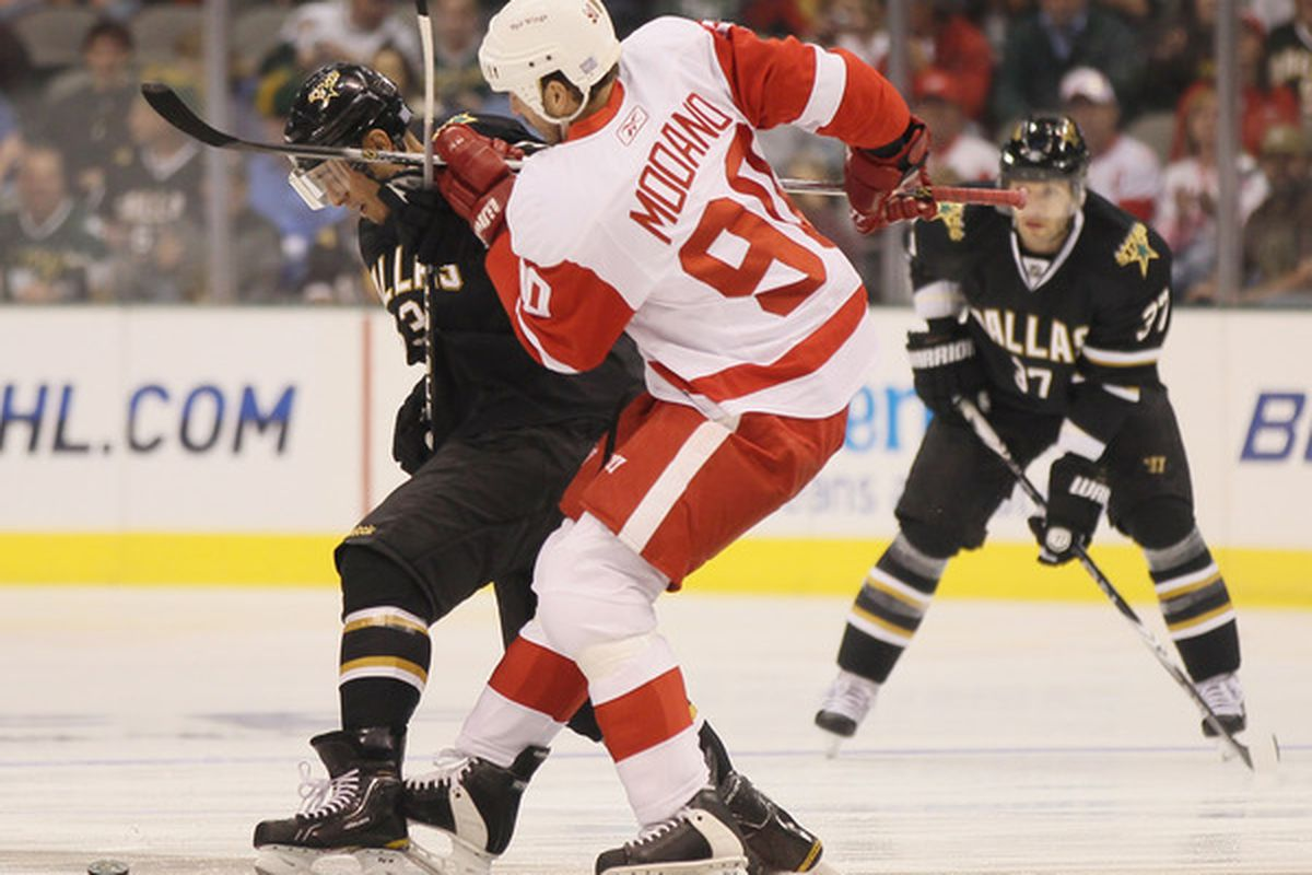 DALLAS - OCTOBER 14:  Mike Modano #90 of the Detroit Red Wings faces off against Mike Ribeiro #63  of the Dallas Stars on October 14 2010 at the American Airlines Center in Dallas Texas.  (Photo by Elsa/Getty Images)